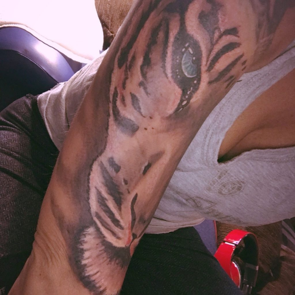 Tiger face tattoo on hand
